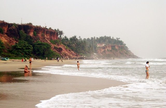 A small strand of beach nuzzles Varkala's cliff edge